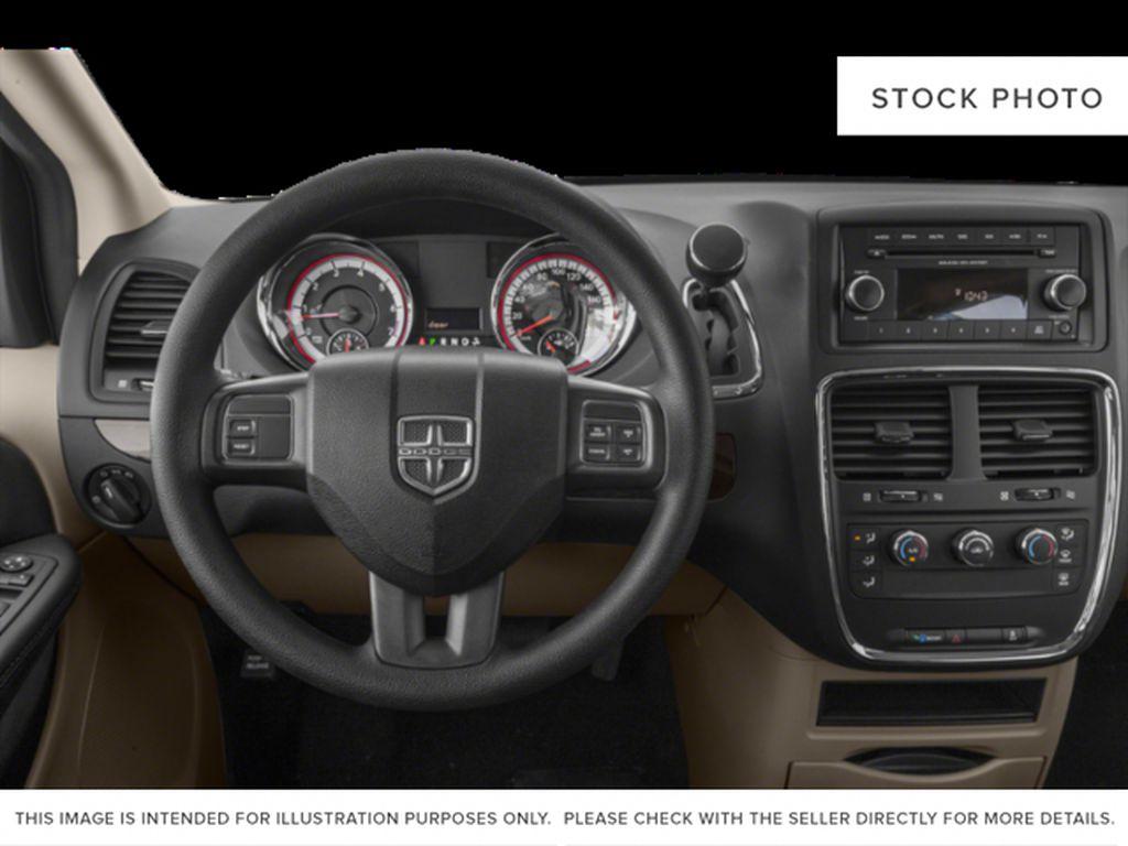 Blue[Indigo Blue] 2020 Dodge Grand Caravan Steering Wheel and Dash Photo in Okotoks AB