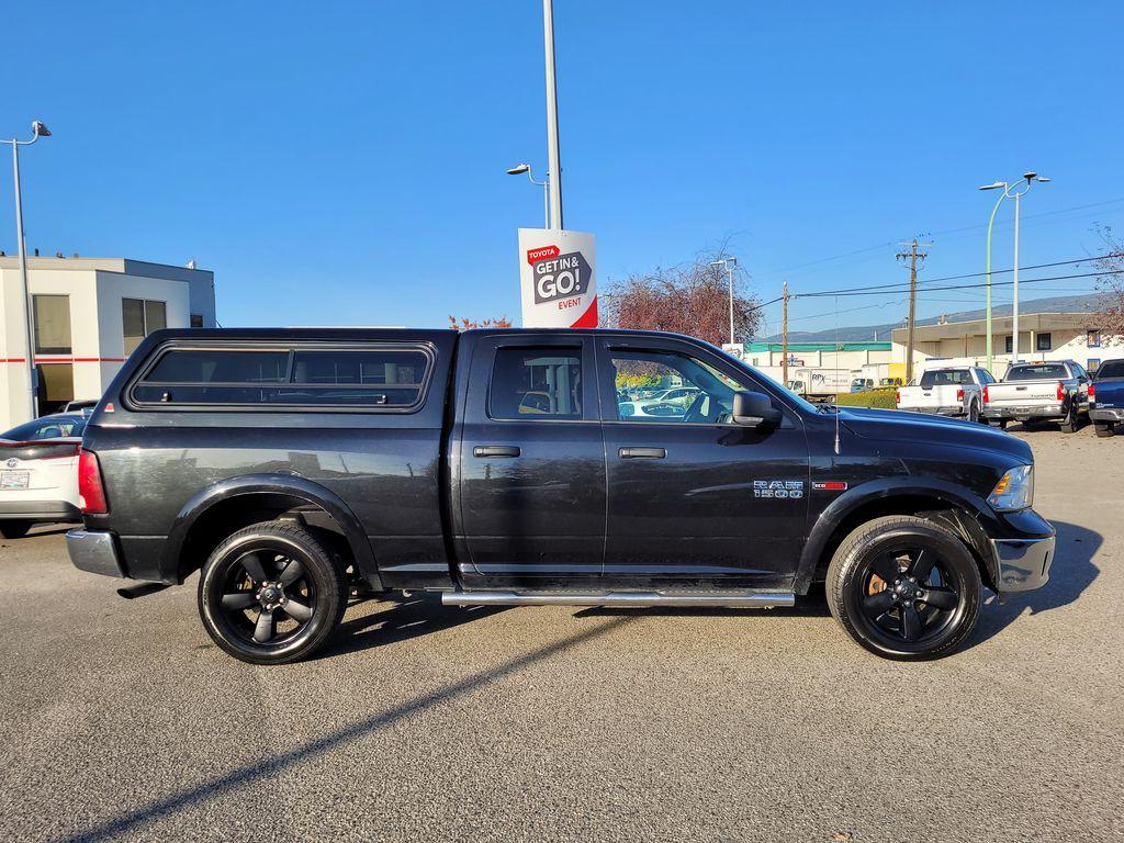 Black[Brilliant Black Crystal Pearl] 2016 Dodge Ram 1500 Outdoorsman 4WD Right Side Photo in Kelowna BC