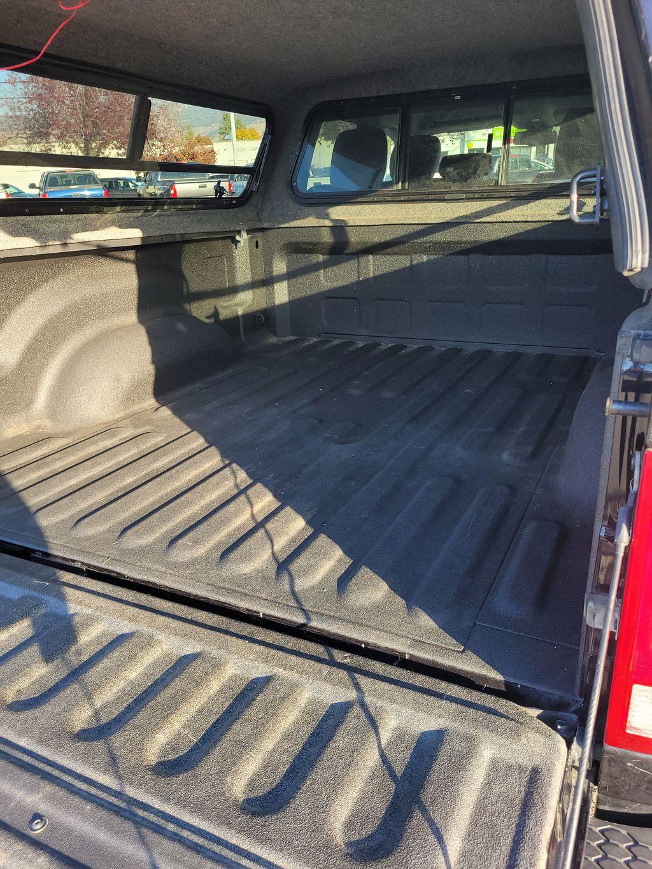 Black[Brilliant Black Crystal Pearl] 2016 Dodge Ram 1500 Outdoorsman 4WD Trunk / Cargo Area Photo in Kelowna BC