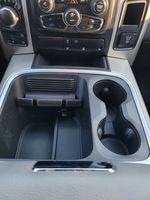 Black[Brilliant Black Crystal Pearl] 2016 Dodge Ram 1500 Outdoorsman 4WD Center Console Photo in Kelowna BC
