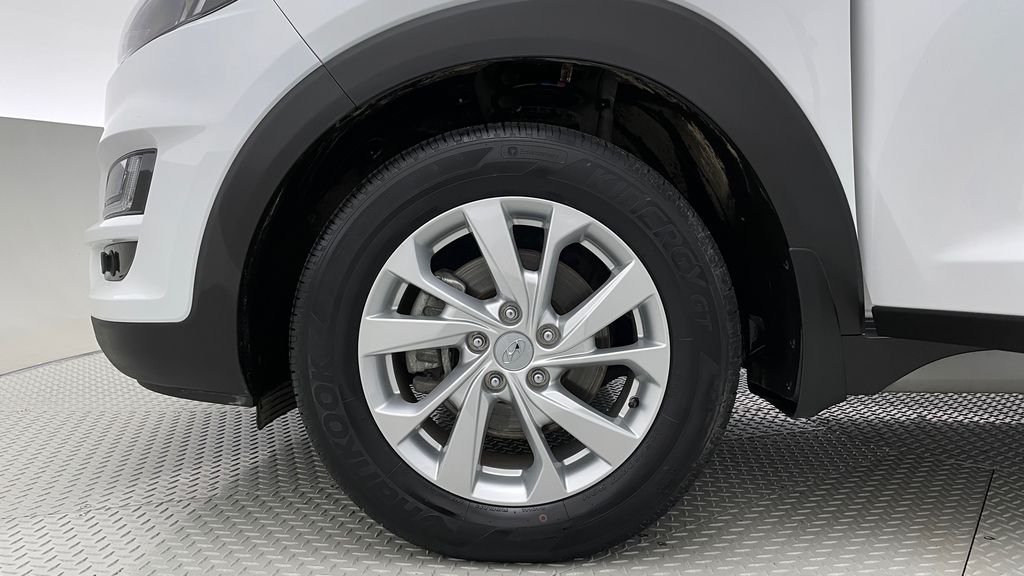 White[Crystal White] 2020 Hyundai Tucson Preferred AWD Left Front Rim and Tire Photo in Winnipeg MB